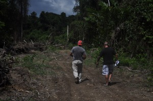 Chad and Pedrro, heading up road to enter Pedro's new lot