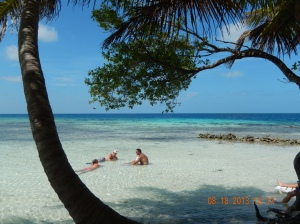 Relaxing in the warm waters on Sanctuary Caye.